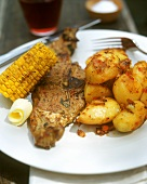 Barbecued lamb cutlet with potatoes and sweetcorn