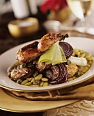 Quails on vegetables (beans, capers and onions)