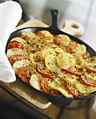 Pan-cooked potato and tomato dish with rosemary