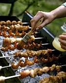 Chicken and shrimp kebabs on a grill