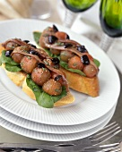 Bruschetta with peeled tomatoes, olives and sardines