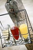 Red & white wine & orange juice in glasses for picnic