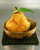 Breaded knuckle of pork in wooden bowl