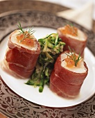Pike-perch roll wrapped in ham with courgette relish