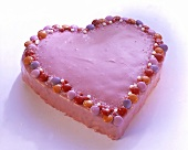 Pink love-heart with smarties and icing