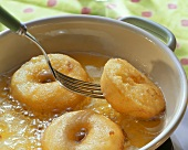Fresh Apple Fritters Frying in Oil