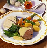 Poultry and meat platter with vegetables and lemon sauce