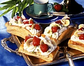 Banana and strawberries slices on puff pastry base