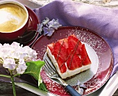 A piece of quark slice with strawberries on a plate