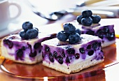 Several pieces of blueberry sour cream cake