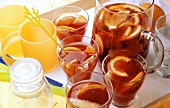 Orange punch in glasses and carafe