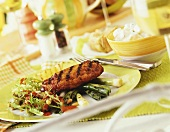 Grilled pork escalope with salad and vegetables on plate