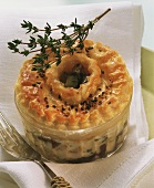 Plate pie with mushroom ragout and fresh thyme