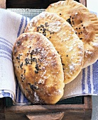 Oven-baked Indian naan bread with succulent filling