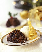 Christmas pudding with spun sugar and ice cream