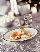 Blinis with crème fraiche and fish, with vodka