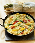 Colourful omelette with asparagus and peppers