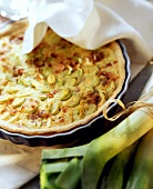 Leek quiche with bacon in a quiche dish