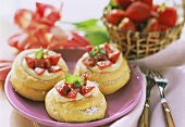 Filled cream puffs with vanilla mousse, strawberries & rhubarb