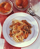 Spaghetti with tomato sauce & duck breast fillets on plate