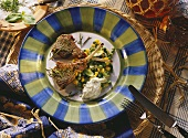 Lamb chop on sweetcorn and peas with herb cream