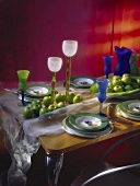 Laid table, decorated with green apples