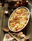 Cauliflower souffle with bacon strips in souffle dish