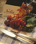 Written place card decorated with vine leaves & grapes