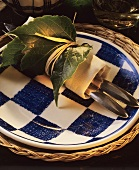 Cutlery rolled in napkin with vine leaves