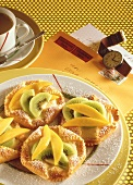 Puff pastry tartlet with cream filling & exotic fruits