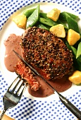 Peppered steak with red wine sauce and vegetables