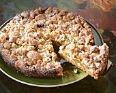 Gooseberry crumble cake, a piece cut