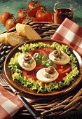 Eggs with anchovy mousse on tomato salad