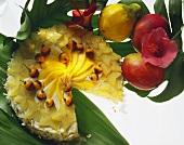 Exotic coconut gateau with carambolas, mangos & physalis