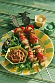 Two chicken and vegetables kebabs with pineapples & dip