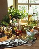 Bottled capers & olives, herbs, oils, vinegar and mortar