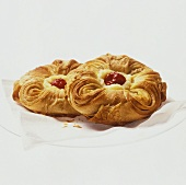 Two puff pastries with blancmange & cherry filling