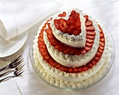 Tiered heart-shaped gateau with strawberries & cream