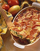 Green rye and spinach casserole with tomatoes