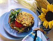 Corn fritters filled with ham, tomato and rocket