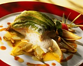 Fish fillet with avocado on chicory leaves