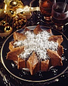 Spice cake star with chocolate icing and grated coconut