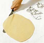 Loosening rolled out biscuit dough from board