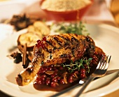 Duck leg with redcurrant sauce and almond flakes