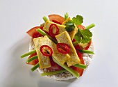 Rice waffle snack with tomatoes, spring onions & tofu