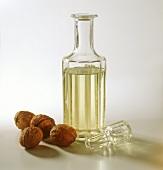 Walnut oil in decorative bottle, decoration: walnuts