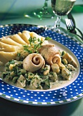 Plaice rolls on asparagus and courgettes