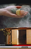 Conchiglioni being dropped into boiling water