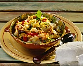 Saffron rice with stockfish, tomatoes and spring onions