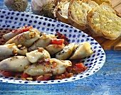 Calamares with meat stuffing, with garlic baguette